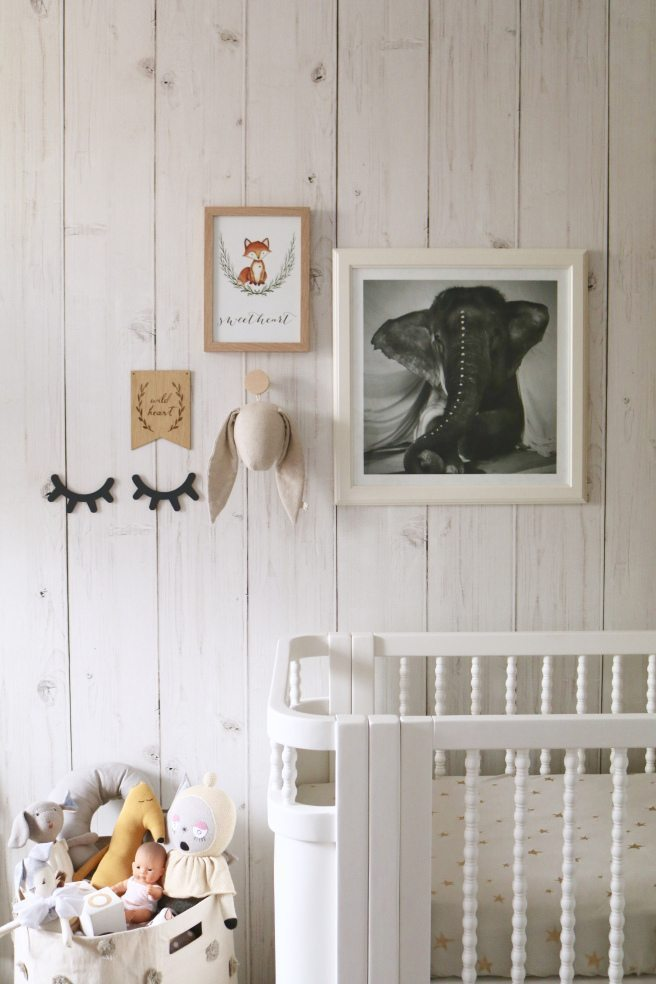 feature wall in a nursery featuring Whitewashed Timber Wallpaper from Milton & King