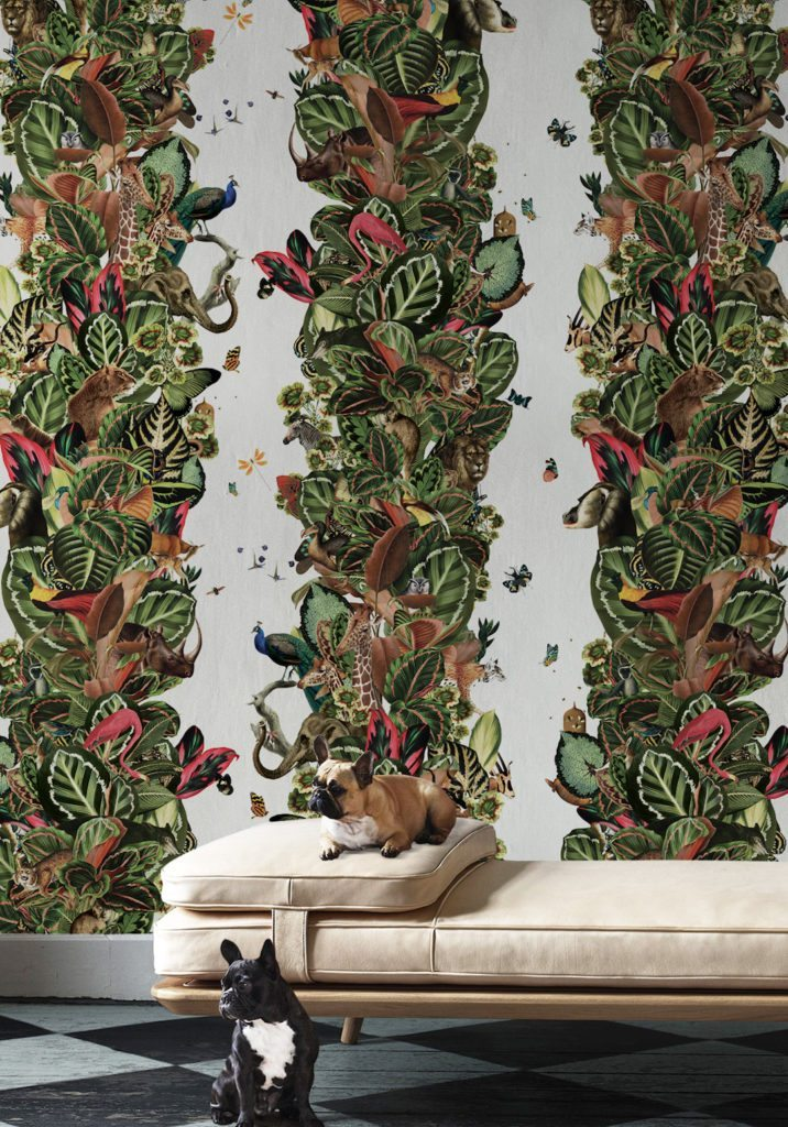 Viva Tropicana by Kingdom Home Wallpaper manufactured and sold by Milton & King showing a crowded jungle of birds and beasts and butterflies among lush tropical foliage