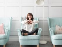 Jillian Harris at the renovation reveal for Mamas For Mamas Charity in front of The Parlour Wallpaper designed by Jillian Harris and manufactured and sold by Milton & King