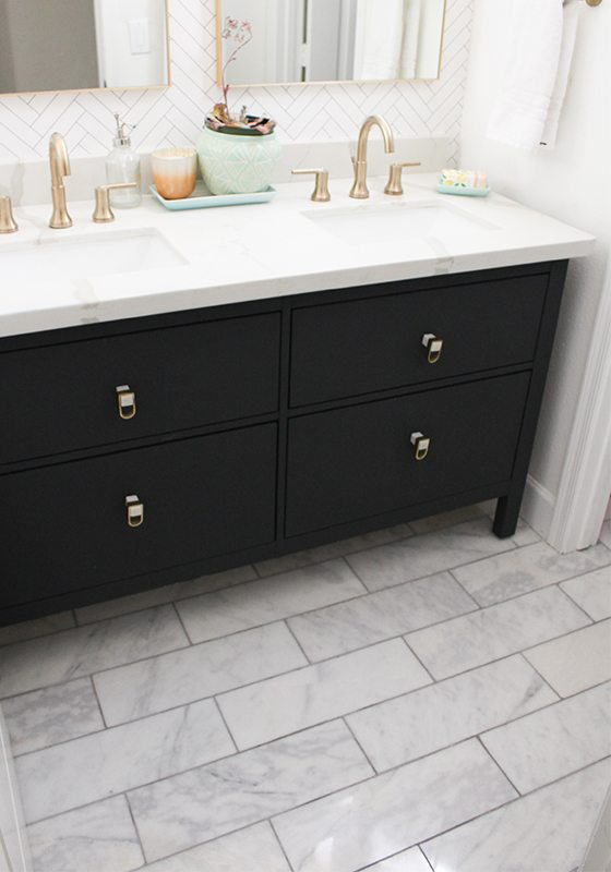 Photo Is Focused On The Dark Cabinetry Of The Vanity Which Looks Like It Is  Painted