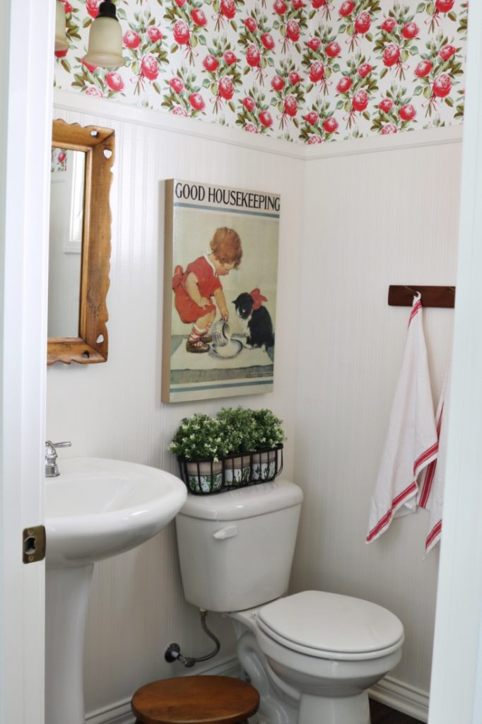 Vintage Bathroom With Floral Wallpaper Around The Top Of Room