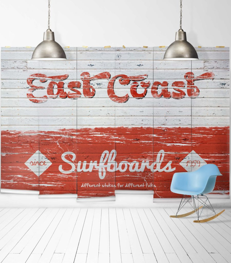 wall mural with white and orange painted faux timber with the words East Coast Surfboards since 1959 Different Strokes For Different Folks