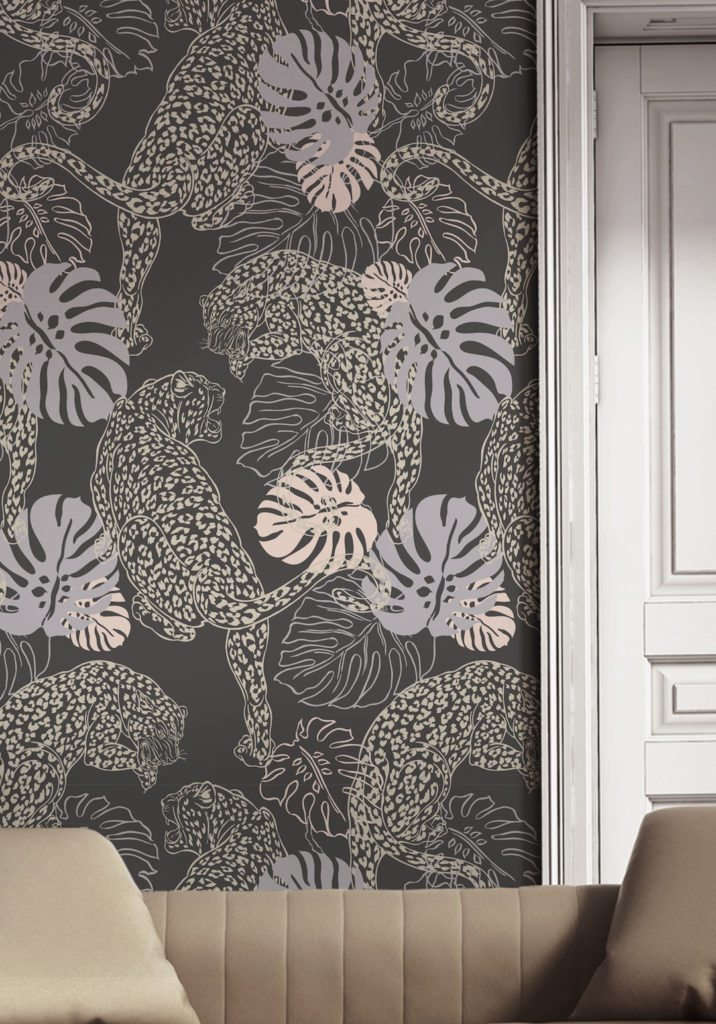 Leopard by Kingdom Home Wallpaper manufactured and sold by Milton & King showing circling leopards among giant leaves