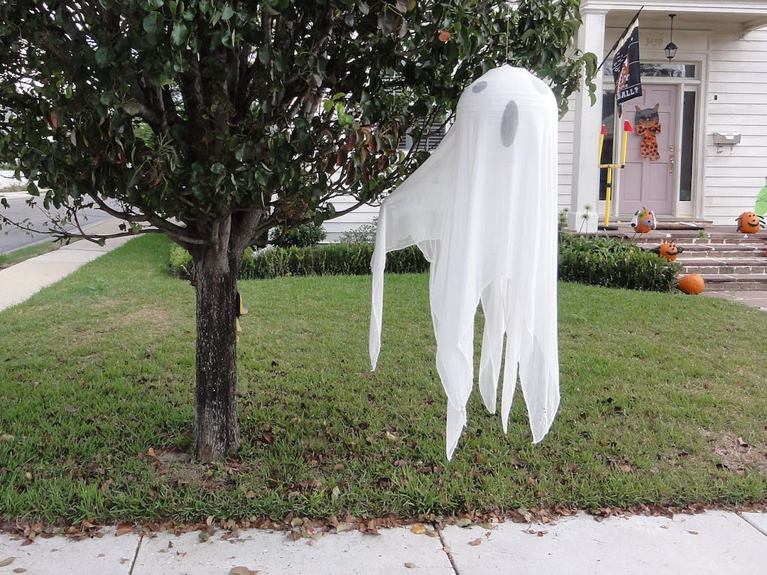 Ghost Halloween Decoration Hanging From a Tree
