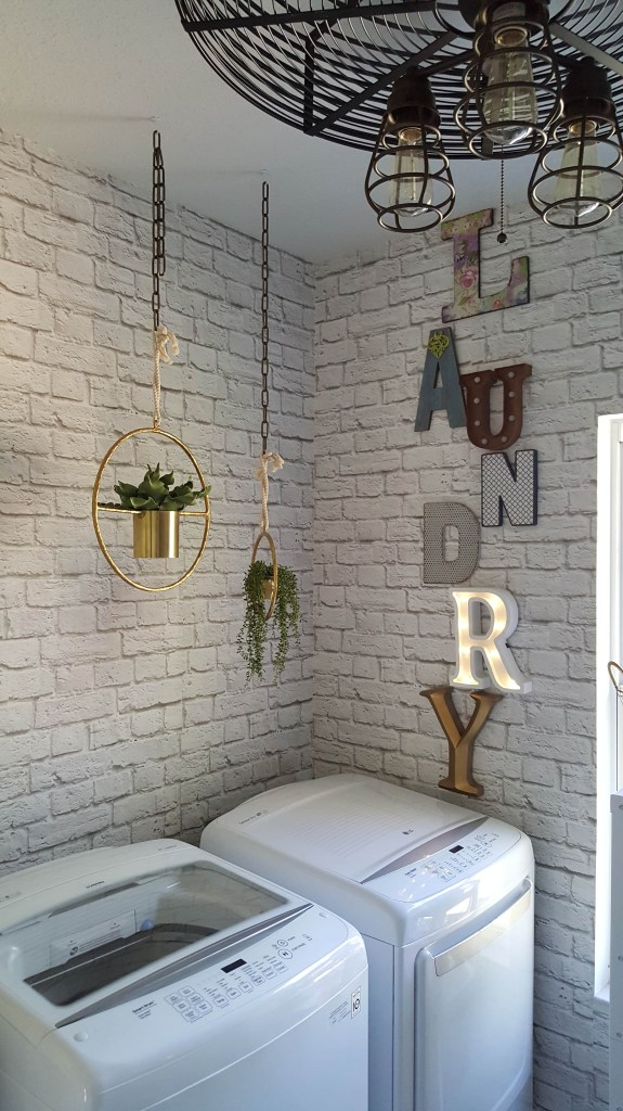 Laundry room with faux brick wallpaper called Soft White Bricks from Milton & King